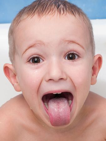Little child making tongue for fun photo