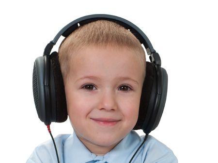 Little child in sound headphones listening music photo