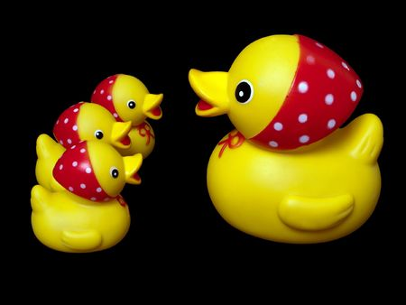 Yellow rubber mother duck toy and child isolated