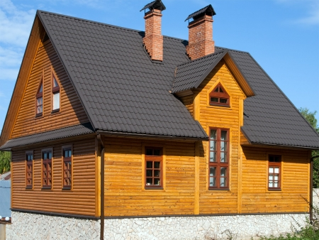 house roof: Log house structure wood building home exterior Stock Photo