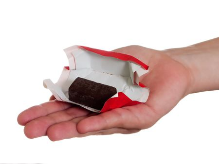 Human hand holding one sweet chocolate candy food photo