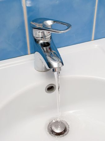 Clean sink and faucet at home toilet or bathroom Stock Photo - 5638812