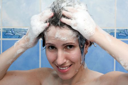 Beauty women take shower in bathroom for hair care photo