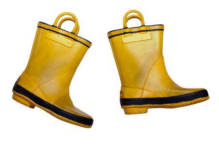 Rain shoe - yellow rubber waterproof boot on white photo