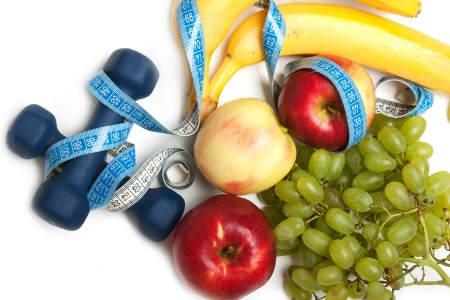 Healthy lifestyle - fruit food, sport exercising Stock Photo