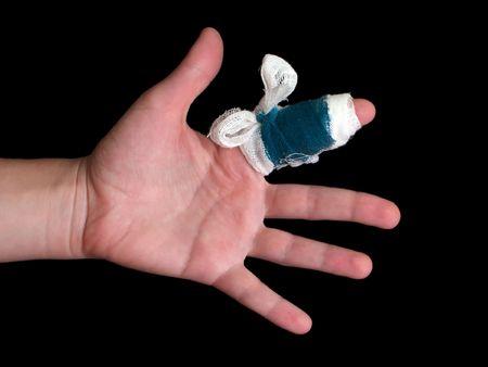 White medicine bandage on human injury hand finger photo