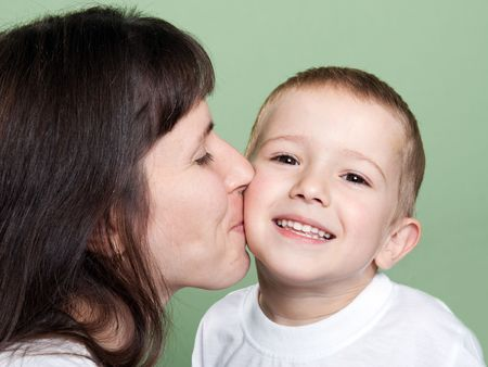 Mother kissing smiling child - family happiness Stock Photo - 5798953