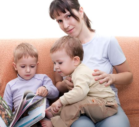 Little child and mother parent reading family book photo