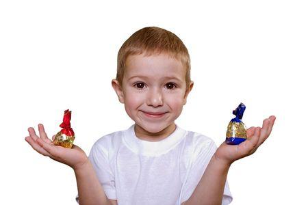 Human hand holding two sweet chocolate candy food photo