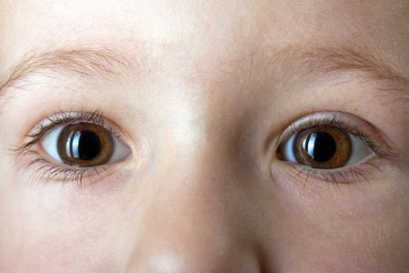 Little human baby child looking eye on face macro photo