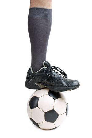 Foot on black white football or soccer sport ball photo