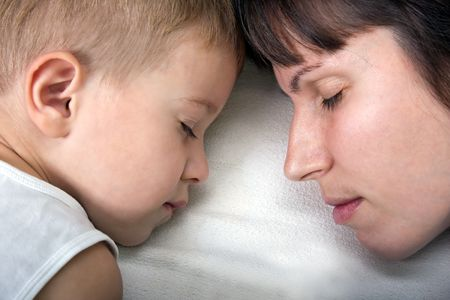 Sleeping mother and cute child in family love life photo