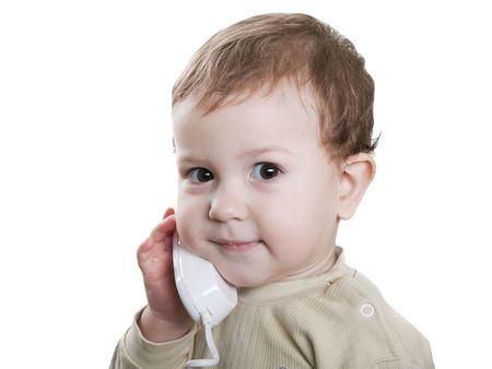 Communication - little child talking telephone photo