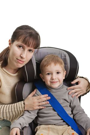 son in law: Mother and little child on vehicle car safety seat