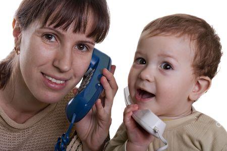 Communication - little child talking telephone photo