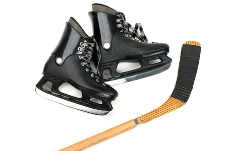 Winter hockey sport ice skates and stick equipment photo