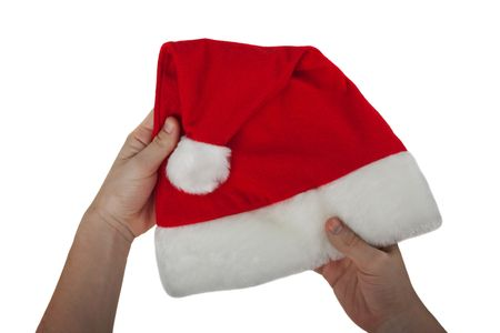 Hand holding Christmas holiday red Santa Claus hat Stock Photo - 6072954