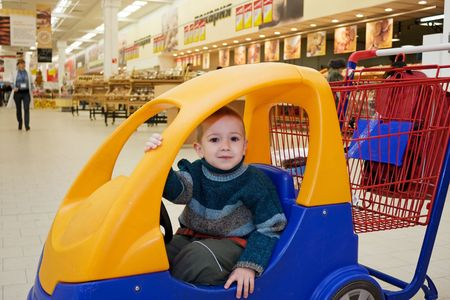 Supermarket store little child shopping cart car photo