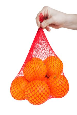 Hand holding healthy eating orange fruit food bag photo