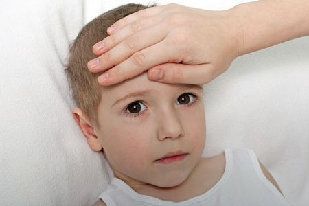 sick in bed: Little illness child medicine flu fever healthcare Stock Photo