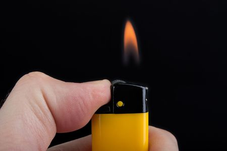Smoking cigarette gas lighter burning fire flame photo