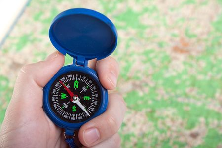Hand holding travel north direction compass on map Stock Photo - 6616247