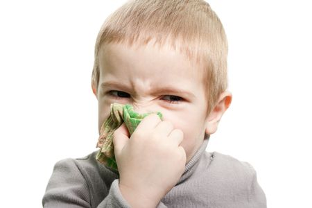 Human child cold flu illness tissue blowing nose photo