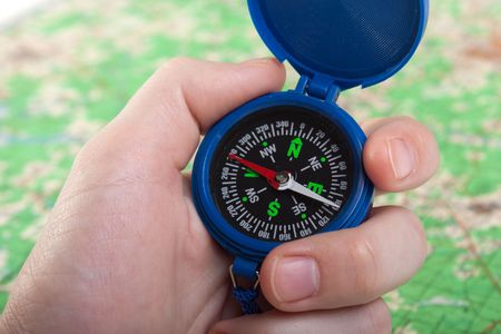 Hand holding travel north direction compass on map Stock Photo - 6736488