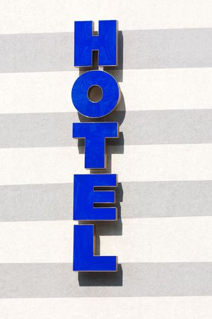 Business travel vacation blue neon city hotel sign photo