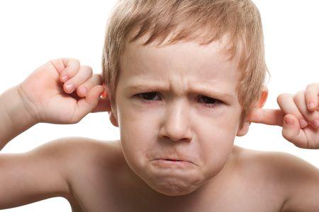Worried human child boy face hand finger close ear photo