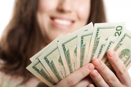Finance businesswomen hand holding dollar currency photo