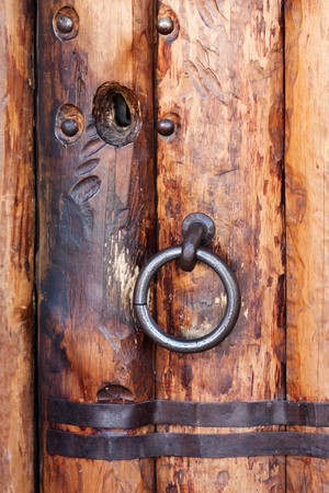 Old church closed entrance with wood door and lock photo
