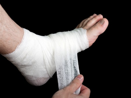 body wound: White medicine bandage on human injury foot Stock Photo