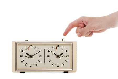 Hand arm pushing white chess sport game time clock photo