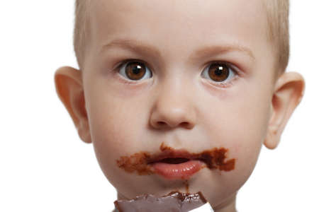 Little child holding sweet chocolate candy food photo