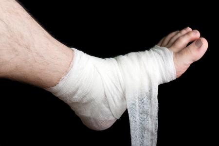 White medicine bandage on human injury foot photo