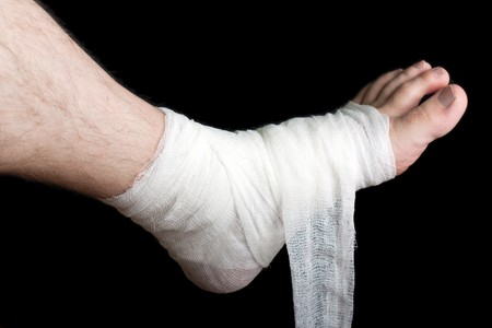 foot doctor: White medicine bandage on human injury foot Stock Photo