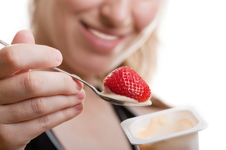 Smiling women eating healthy lifestyle yogurt food photo