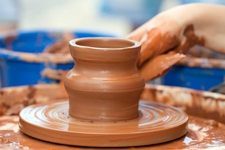 Pottery craft wheel ceramic clay potter human hand photo