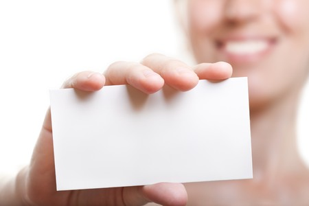 Human hand holding white empty blank business card photo