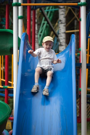 Little child fun playing playground slide outdoor Stock Photo - 7526422