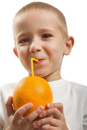 citrus family: Child hold healthy eating orange fruit juice drink Stock Photo