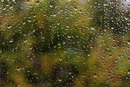 window light: Wet glass window rain water drop textured pattern