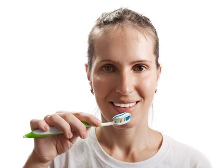 Women and dental hygiene toothbrush brushing teeth photo