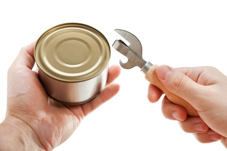 Hand holding canned preserved food metal can opener photo