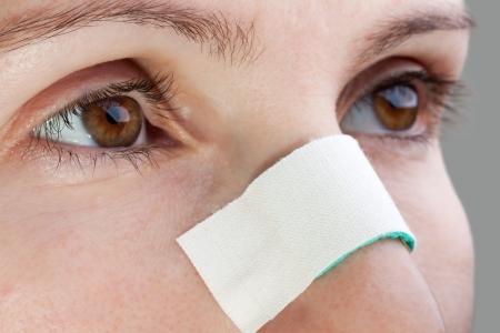 Plaster on human blood injury wound nosebleed nose Stock Photo - 7952257