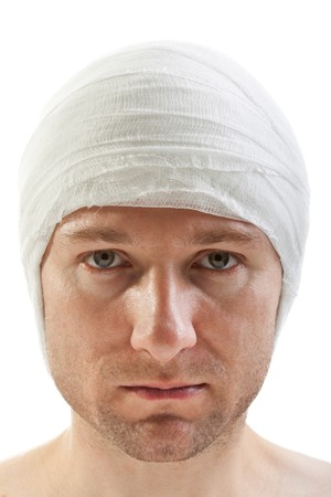 head injury: White bandage on human brain concussion wound head