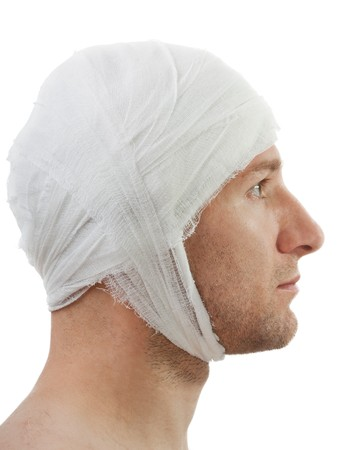 contusion: White bandage on human brain concussion wound head