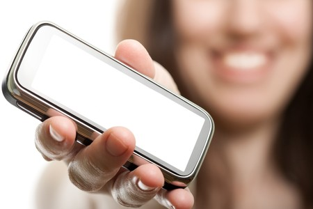 Smiling women holding mobile communication phone photo