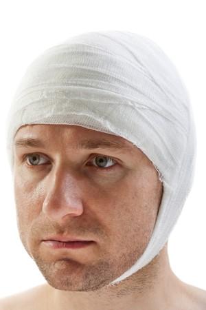concussion: White bandage on human brain concussion wound head